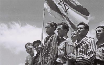 """A GROUP OF FORMER BUCHENWALD INMATES ON BOARD THE REFUGEE SHIP """"MATAROA"""" IN HAIFA PORT.ðéöåìé ùåàä îîçðä áåëðååàìã, îâéòéí ìðîì çéôä."""